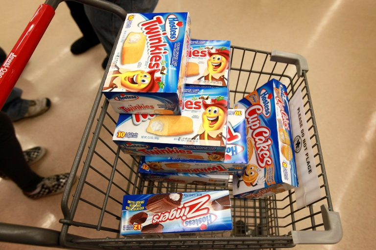<p>A customer heads to the checkout with a shopping cart loaded with Hostess snacks at a Jewel-Osco grocery store on December 11, 2012 in Chicago, Illinois. Hostess Brands Inc. shut down its baking operations and began liquidating assets last month after failing to negotiate a labor contract with Workers with the Bakery, Confectionery, Tobacco Workers and Grain Millers International Union.</p>