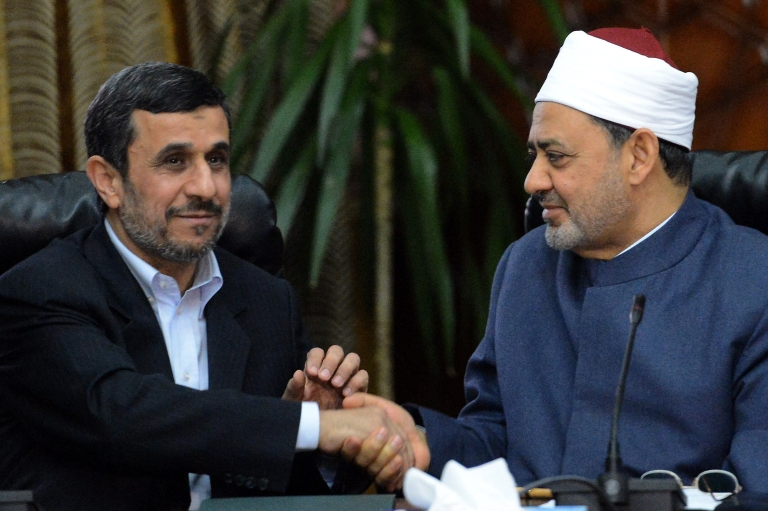 <p>Egyptian Grand Imam of Al-Azhar Sheikh Ahmed al-Tayeb (R) shakes hands with Iranian President Mahmoud Ahmadinejad during a meeting at Al-Azhar headquarters in Cairo on February 5, 2013. Ahmadinejad held talks in Cairo on the divisive issue of Syria's war, as he kicked off the first visit to Egypt by an Iranian president since 1979.</p>