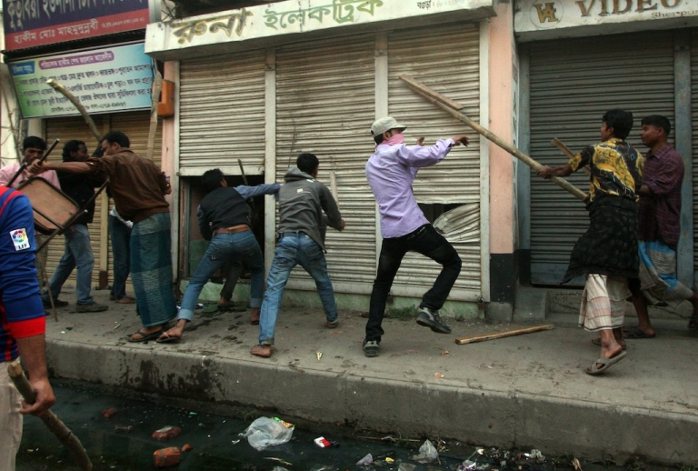 <p>Bangladeshi Islamist activists vandalize shops during clashes with police in Bogra some 120kms north of Dhaka on March 3, 2013. Bangladesh deployed troops in the north of the country after 16 more people were killed in a fresh wave of violence over the conviction of Islamist leaders for war crimes in the Muslim-majority nation.</p>