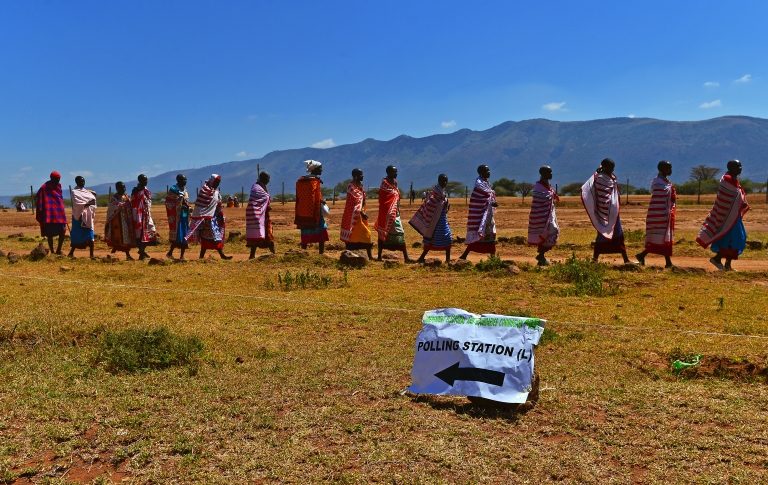 <p>Maasai tribes-people leave after voting in Ilngarooj, Kajiado South County, Maasailand, on March 4, 2013 during Kenya's elections.</p>