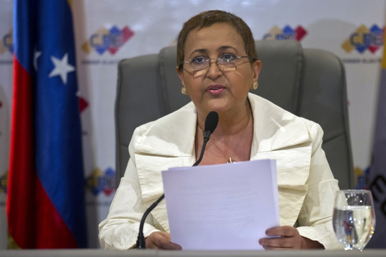 <p>The president of the Venezuelan National Electoral Council (CNE), Tibisay Lucena, speaks during a press conference at the CNE headquarters in Caracas, on March 9, 2013. Venezuela will hold a presidential election to succeed late leader Hugo Chavez next April 14, the national electoral council announced Saturday.</p>