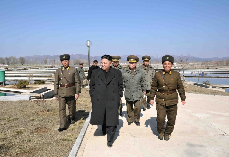 <p>This undated picture released by North Korea's official Korean Central News Agency on March 12, 2013 shows North Korean leader Kim Jong-un (C) inspecting culture ponds of the Ryongjong Fish Farm in South Hwanhae province.</p>