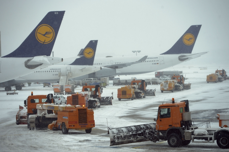 <p>Snow plows pass Lufthansa airplanes on there way to the runway at Frankfurt International Airport on March 12, 2013 in Frankfurt am Main, Germany.</p>