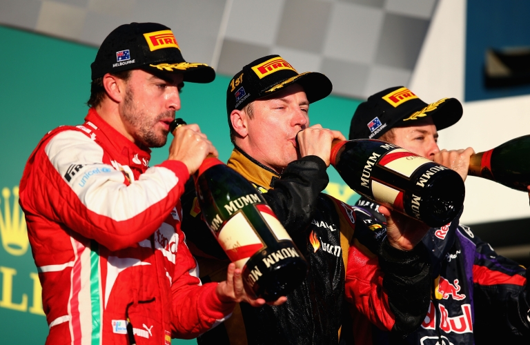 <p>Race winner Kimi Raikkonen (C) of Finland and Lotus celebrates on the podium with second placed Fernando Alonso (L) of Spain and Ferrari and third placed Sebastian Vettel (R) of Germany and Infiniti Red Bull Racing following the Australian Formula One Grand Prix at the Albert Park Circuit on March 17, 2013 in Melbourne, Australia.</p>