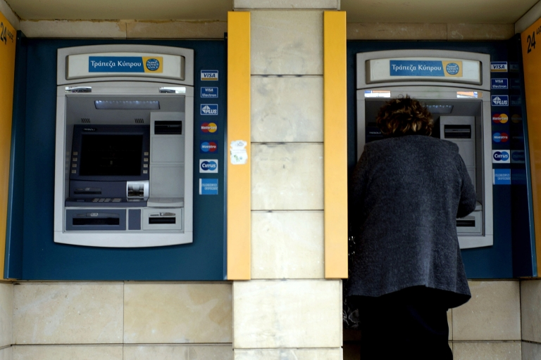 <p>Woman uses ATM machine in Bank Of Cyprus in Nicosia. The Cypriot banking crisis has sparked interest in the digital currency Bitcoin. There is even talk of Bitcoin's first ATM opening in Cyprus.</p>