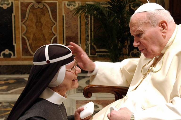 <p>Pope John Paul II blesses the head Catholic order of nuns, the Brigittines, Sister Tekla Famiglietti, in the Clementine Hall at the Vatican.</p>