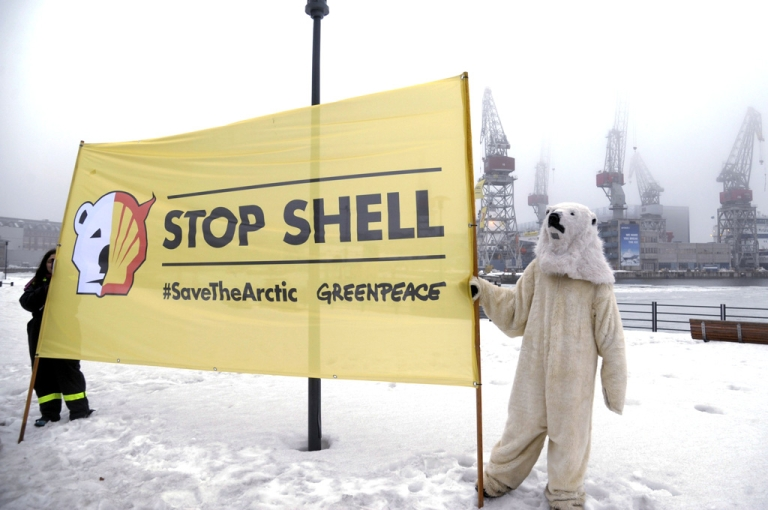 <p>Greenpeace activists demonstrate on March 16, 2012 in the port of Helsinki as other activists occupy a Shell-contracted icebreaker preparing to sail for the Arctic. Fennica and Nordica, two Finnish icebreakers whose main task is to secure shipping in the Baltic Sea, have been leased out to Shell for the summer seasons of 2012, 2013 and 2014 to help Shell drill in the Beaufort and Chukchi seas off Alaska.</p>