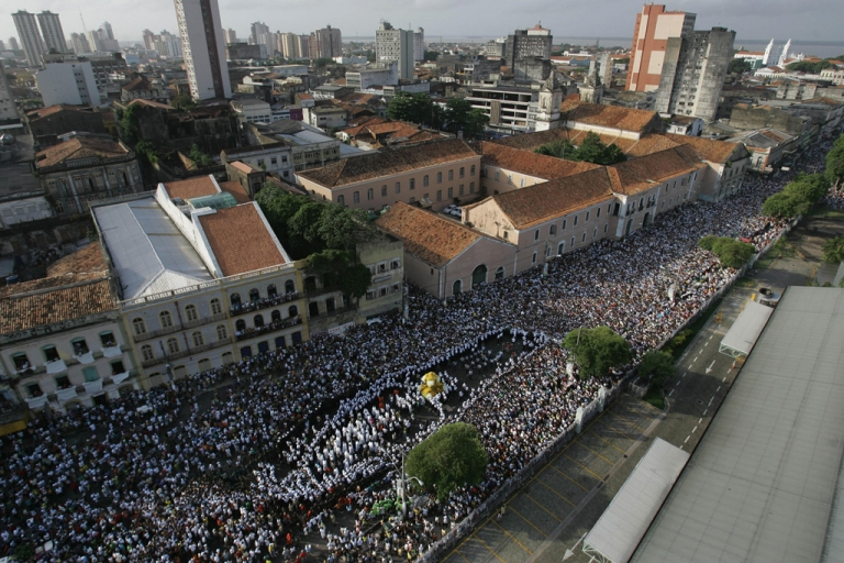 <p>Thousands of Roman Catholic devotees follow the image of Our Lady of Nazareth at port area during the 'Cirio de Nazare' (Nazareth Candle) celebrations in Belem, northern Brazil, on October 12, 2008. Nearly two million pilgrims participated in Brazil's biggest Catholic procession.</p>