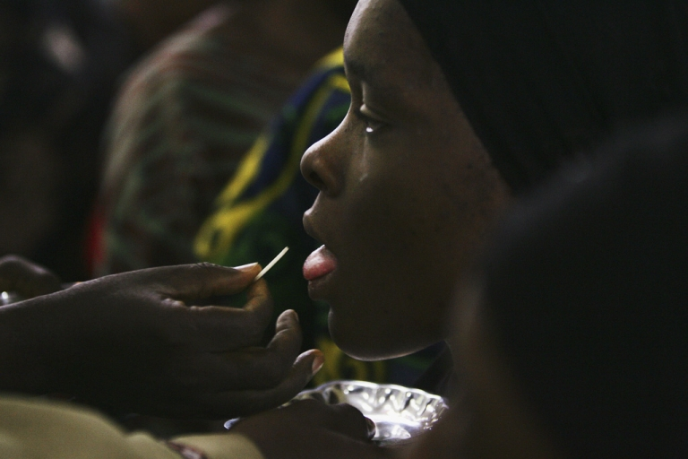 <p>A Nigerian Catholic girl gets communion during morning mass April 12, 2005 in Kano, Nigeria. Kano is part of Nigeria's primarily Muslim north, but devoted Catholic minority participates in frequent Masses in local cathedrals.</p>
