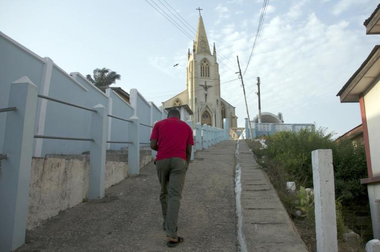 <p>A man walks on February 17, 2013 toward the St. Frances de Sales Cathedral in Cape Coast, Ghana.</p>