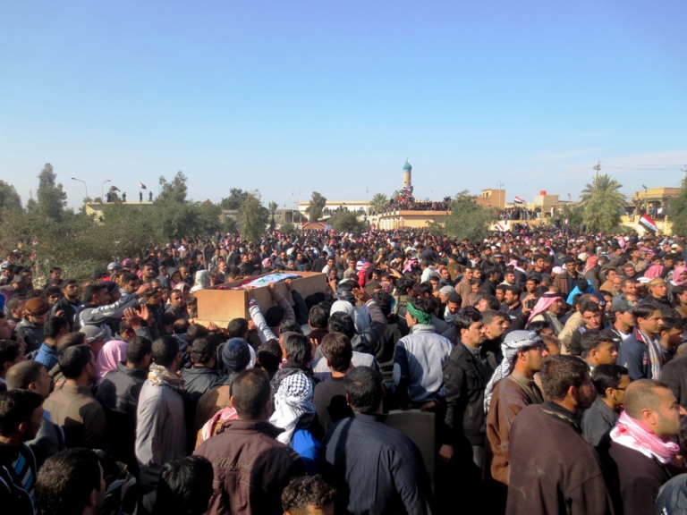 <p>Iraqis gather during the funeral of one of six people killed by Iraqi troops the day before during a protest in the town of Fallujah, west of the Iraqi capital Baghdad on January 26, 2013. The deaths in the predominantly Sunni town were the first since protests began last month, and came as tens of thousands rallied in Sunni areas of the country, railing against alleged targeting of their minority by the Shiite-led authorities. AFP PHOTO/AZHAR SHALLAL        (Photo credit should read AZHAR SHALLAL/AFP/Getty Images)</p>