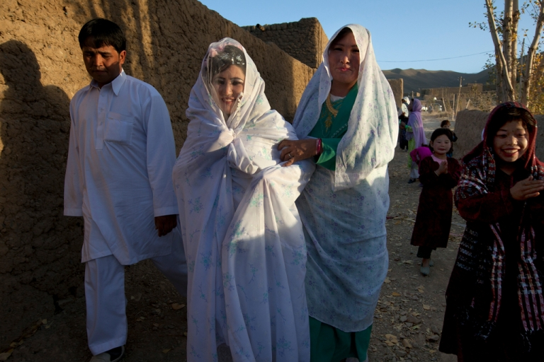 <p>Afghan bride Zahara, 24, is held by the groom Gulam Ali and her sister as they walk to the wedding ceremony held at the family house Oct. 14, 2010 in Bamiyan, Afghanistan.</p>