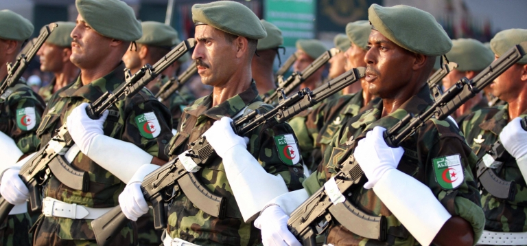 <p>Algerian troops march during a military parade.</p>