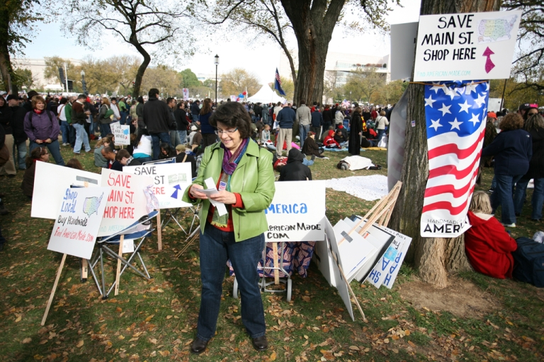 <p>Sue Fleischer, of Casual-Elegance.com, carries out a campaign to support American made products during the Rally to Restore Sanity near the US Capitol Building on Oct. 30, 2010, in Washington, DC.</p>