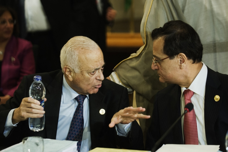 <p>Arab League Secretary-General Nabil Elaraby, left, and Lebanese Foreign Affairs Minister Adnan Mansur speak during the opening session of the Arab foreign minister meeting in Cairo on March 6, 2013.</p>