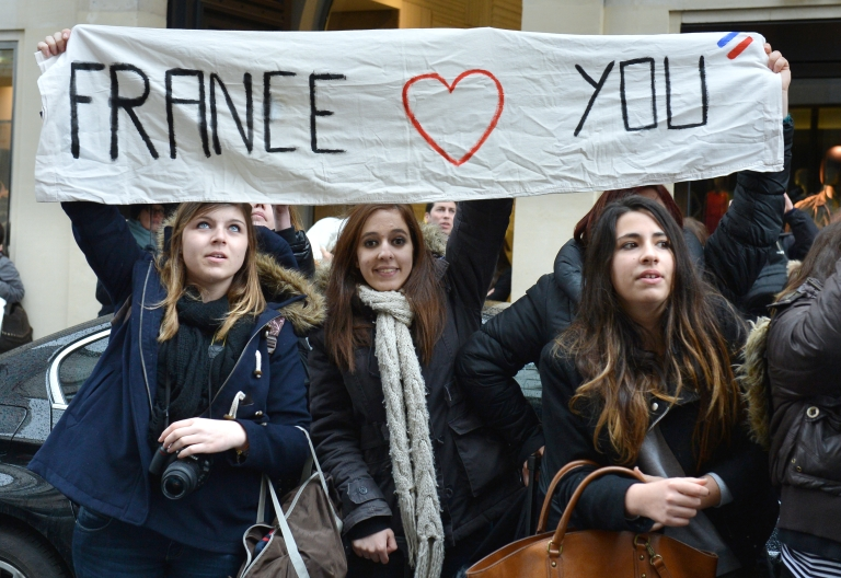 <p>Fans of Justin Bieber hold a banner reading 'France loves you' as they gather outside his hotel on March 18, 2013 in Paris, on the eve of his concert for the 'I Believe' tour at the Palais Omnisport de Paris-Bercy (POPB).</p>