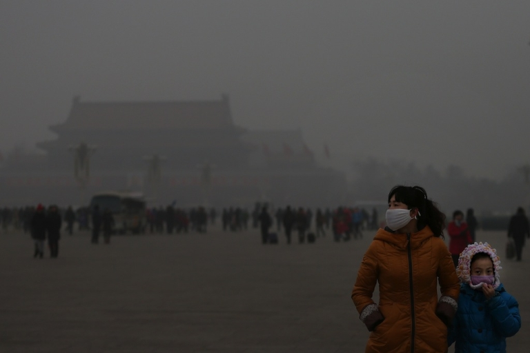 <p>A tourist and her daughter wearing the masks visit the Tiananmen Square at dangerous levels of air pollution on Jan. 23, 2013 in Beijing, China.</p>