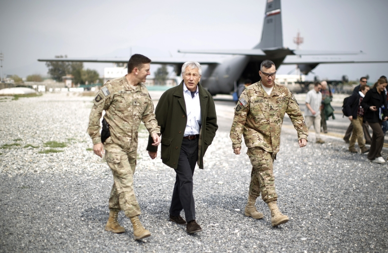 <p>JALALABAD, AFGHANISTAN - MARCH 9:  US Defense Secretary Chuck Hagel (C) arrives to speak to members of the 101st Airborne Airborne Division at Jalalabad Airfield on March 9, 2013 near the southeast of Jalalabad city, Afghanistan. Hagel is on his first official trip since being sworn in as US President Obama's Defense Secretary.</p>