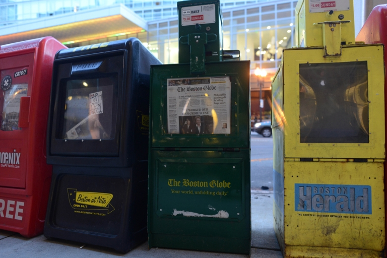 <p>A newspaper box offers copies of The Boston Globe, The Boston Herald and The Boston Phoenix. The Boston Phoenix announced that it would be stopping publication immediately on March 14, 2013.</p>