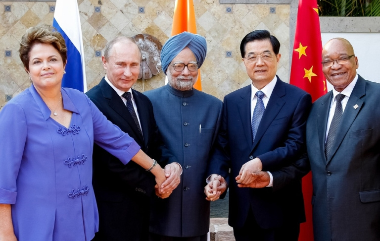 <p>Brazilian President Dilma Roussef (L to R), Russian President Vladimir Putin, Indian Prime Minister Manmohan Singh, Chinese President Hu Jintao and South African President Jacob Zuma join their hands during a BRICS's Presidents meeting in Los Cabos, Baja California, Mexico on June 18, 2012 before the opening of the G20 leaders Summit.</p>