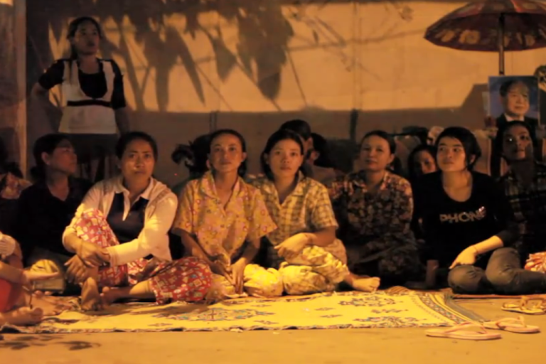 <p>Workers hold a vigil on the sidewalk outside the Kingsland factory in Phnom Penh, Cambodia, where they've been since January demanding severance pay from Wal-Mart and H&amp;M.</p>