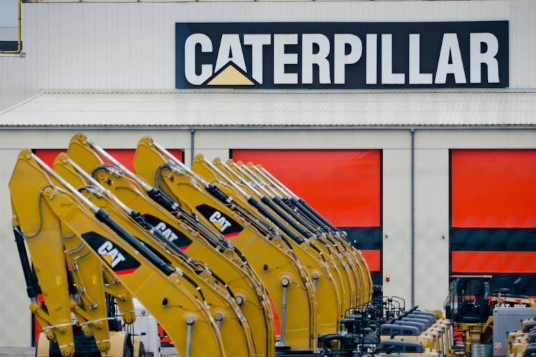 <p>Photo shows a line of vehicles during an extraordinary works council at Caterpillar in Gosselies, Belgium on Feb. 28, 2013.</p>