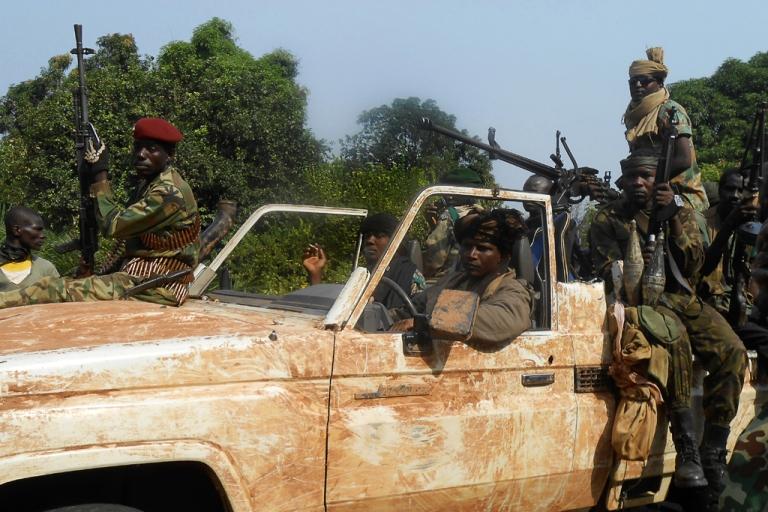 <p>Seleka rebels patrol the roads near the Central African Republic city of Damara on January 8, 2013.</p>