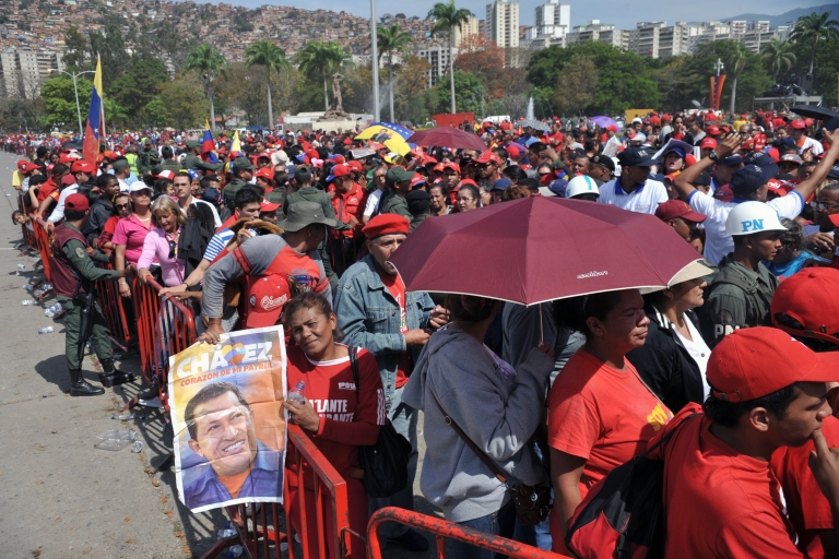 <p>Thousands of supporters of the late Venezuelan President Hugo Chavez queue outside the Military Academy chapel to pay last respects to the leader on March 7, 2013 in Caracas.</p>
