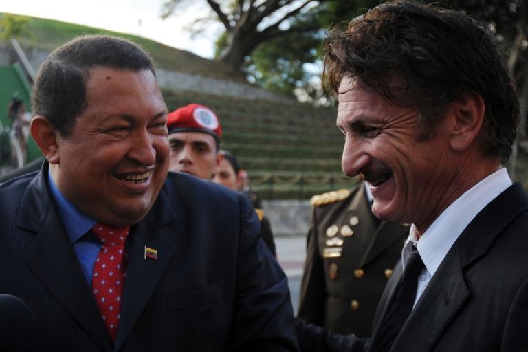 <p>Venezuelan President Hugo Chavez and actor Sean Penn speak to the press at the Miraflores presidential palace in Caracas on Feb. 16, 2012.</p>