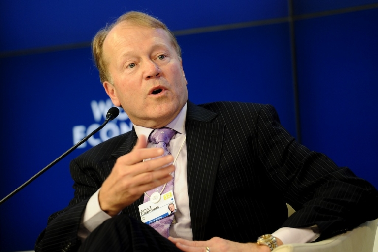 <p>John T. Chambers, Chairman and Chief Executive Officer of Cisco, gestures on Jan. 25, 2012 during the 'The Global Business Context' meeting as part of the World Economic Forum (WEF) at the Swiss resort of Davos.</p>
