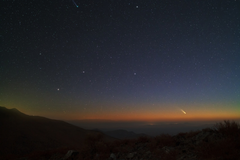 <p>Two impressive comets will both reach their peak brightness during the next two weeks. Comet C/2011 L4 (PanSTARRS), visible near the horizon on the lower right, is showing a bright tail dominated by dust reflecting sunlight.</p>