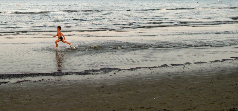 <p>A Cypriot boy runs on a beach in Larnaca.</p>