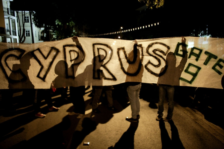 <p>Cypriots protests against EU at protest outside a Eurogroup meeting at the European Council building on March 24, 2013 in Nicosia, Cyprus. Talks between the the International Monetary Fund (IMF) and European Union (EU) led to a bailout agreement which would drastically alter Cyprus' financial sector.</p>