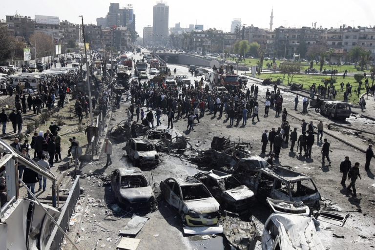 <p>A general view shows burnt cars at the scene of a powerful car bomb explosion in Damascus on Feb. 21, 2013. The blast killed dozens of people, not to mention causing widespread destruction across the city.</p>
