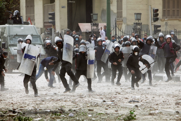 <p>Egyptian riot police charge towards protesters near Egypt's Interior Ministry, as violent demonstrations continued into their second day on Feb. 3, 2012 in central Cairo, Egypt. As the country's turmoil continues and huge swaths of the police force strike to protest their working conditions, the government is exploring private security companies as possible replacements.</p>
