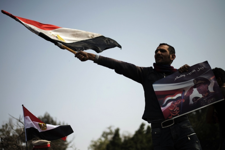<p>Almost every Friday opposition groups protest against President Mohamed Morsi. Here an Egyptian protester waves his national flag in Cairo on March 1, 2013.</p>