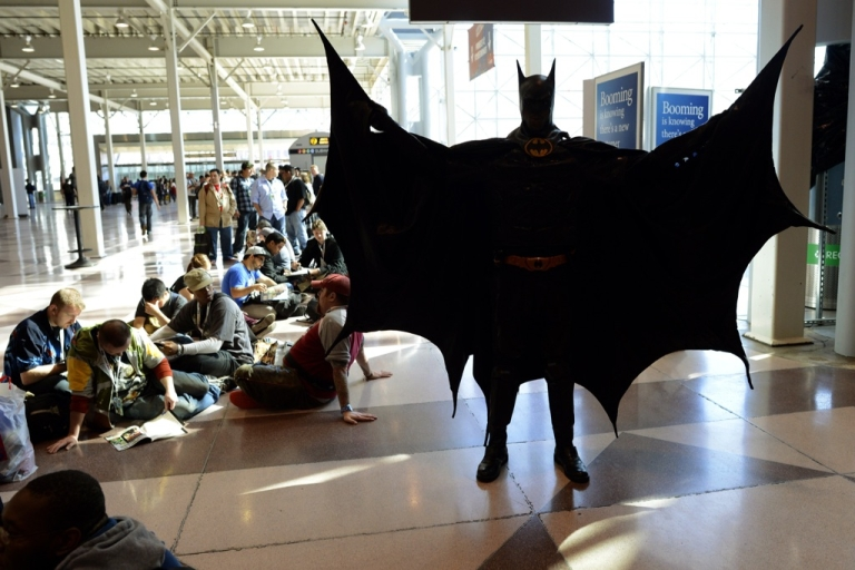 <p>A man dressed as Batman waits with other fans during the opening session of the 2012 New York Comic Con at the Jacob Javits Center October 11, 2012. A man dressed as Batman delivered a criminal to police in Bradford, England on Feb 25, 2013.</p>