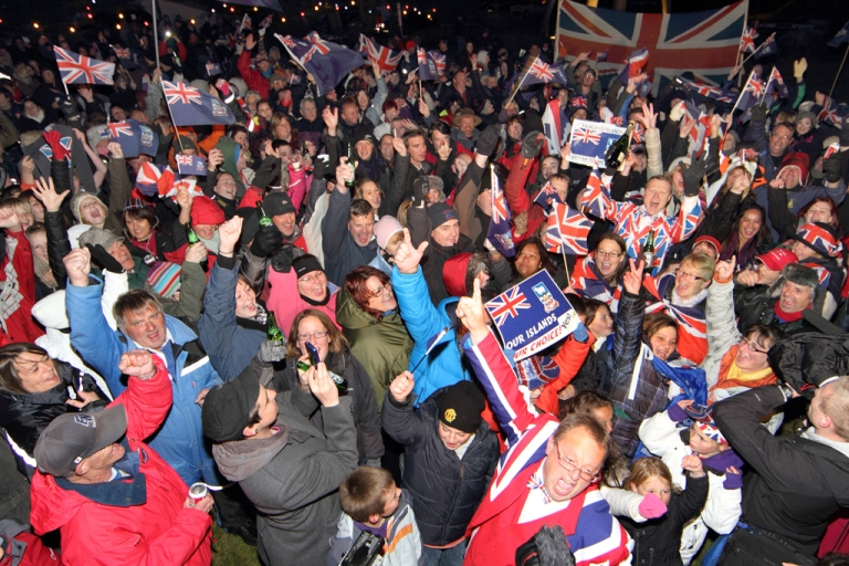 <p>Residents of the Falkland Islands celebrate in the capital city of Port Stanley after the announcement of the referendum's results on March 11, 2013. Almost all of the islanders voted to remain a British Overseas Territory, with three lone voices voting in favor of Argentina.</p>