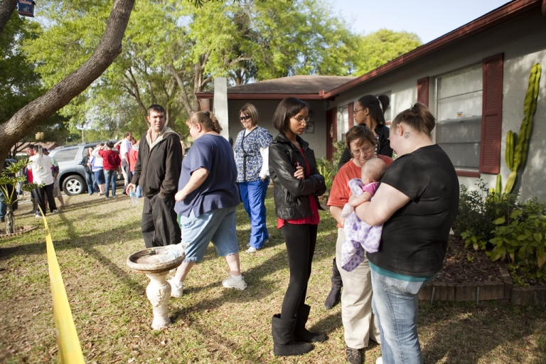 <p>A crowd gathers at the home of Jeff Bush after he fell into a sinkhole while lying in bed March 1, 2013, in Seffner, Florida. Emergency crews were not able to reach Bush after he disappeared and now say it is a recovery mission.</p>