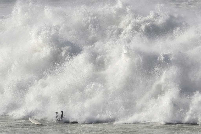 <p>A surfer falls while taking part in the Arnette Punta Galea Big Wave World Tour on Jan. 28, 2013, in the Northern Spanish Basque town of Getxo.</p>