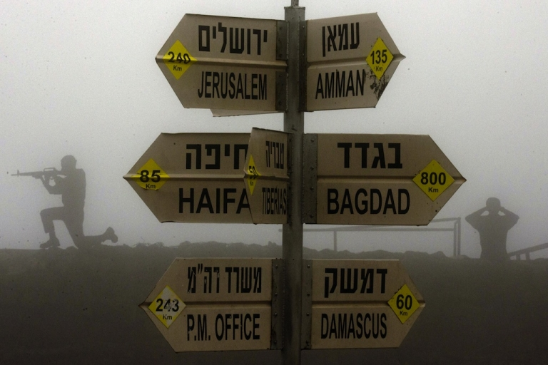 <p>A sign showing the different distances to Jerusalem, Baghdad, Damascus and other locations is seen at an army post in Mount Bental in the Golan Heights.</p>