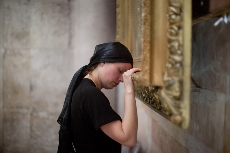 <p>A Christian worshiper prays at the Church of the Holy Sepulchre during the Good Friday on March 29, 2013 in Jerusalem's Old City, Israel. Good Friday is celebrated by Christians throughout the world as the day Christ was crucified on the cross in the lead up to his resurrection on Easter.</p>