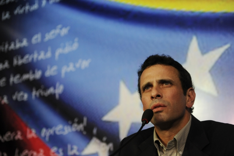 <p>Venezuelan opposition leader Henrique Capriles speaks at a press conference in Caracas on March 10, 2013. Capriles announced Sunday that he will run in the April 14 presidential election against interim President Nicolas Maduro.</p>