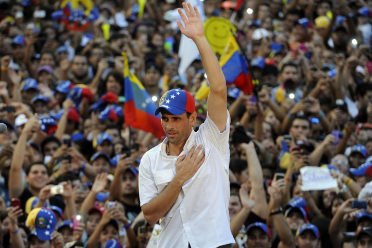 <p>Venezuelan presidential candidate, Henrique Capriles, gestures during a campaign rally in Naguanagua, Carabobo state, Venezuela, on March 21, 2013.</p>