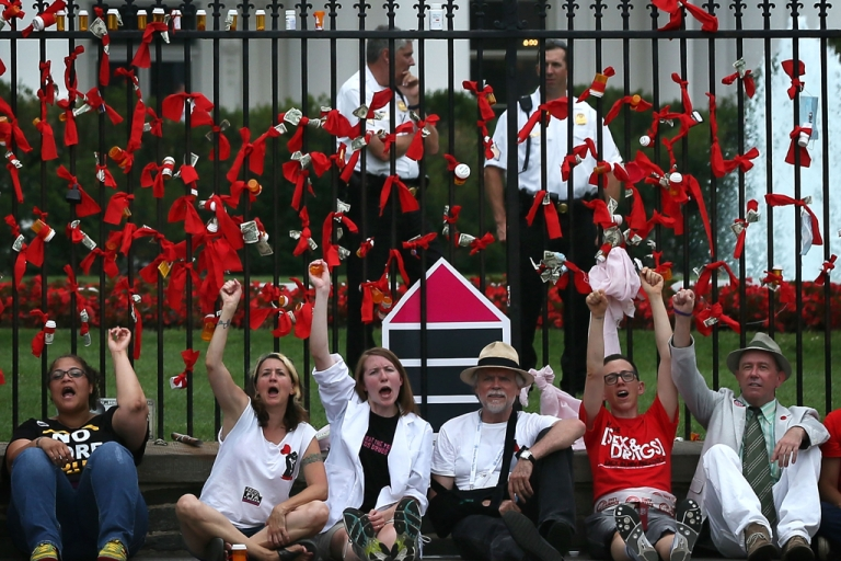 <p>Activists participate in a campaign of civil disobedience outside the White House after a march from the Walter E. Washington Convention Center on July 24, 2012, in Washington, DC. AIDS activists from organizations all around the world participated in the march to