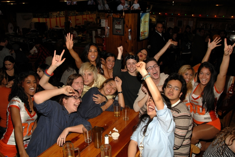 <p>This photo shows the atmosphere at Hooters during the broadcast of Super Bowl XLV on Feb. 6, 2011, in New York City. Middling sales have forced the restaurant chain to consider overhauling its brand in favor of drawing new customer bases.</p>