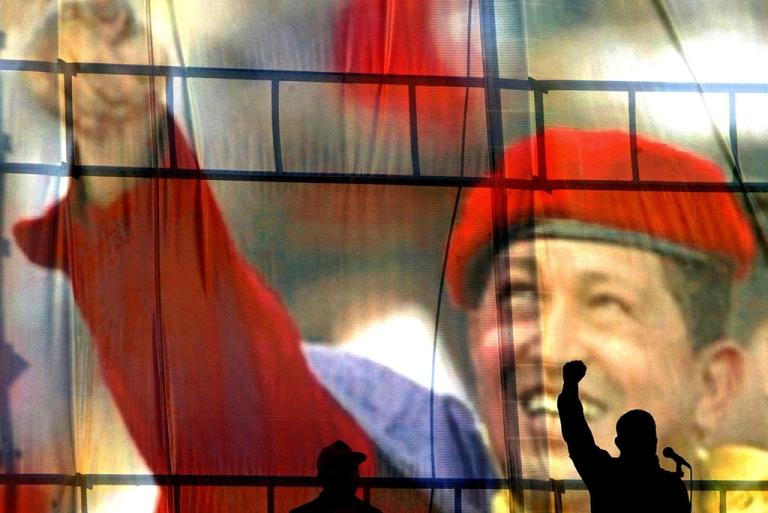<p>Venezuelan President Hugo Chavez raises his fist Dec. 6, 2003.</p>