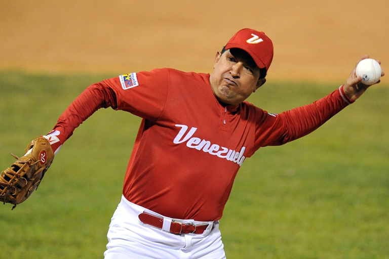 <p>Venezuelan President Hugo Chavez prepares to toss a ball before a softball match with professional Venezuelan players in Caracas on February 11, 2010. Chavez died on March 5, 2013, at age 58 after a year long battle with cancer.</p>