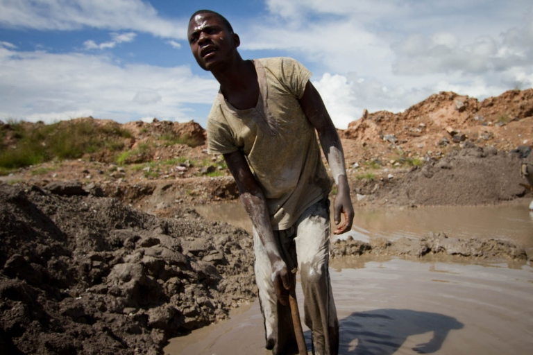 <p>A man digs in muddy water for copper ore as part of an artisanal mining operation in Kolwezi, Congo.</p>