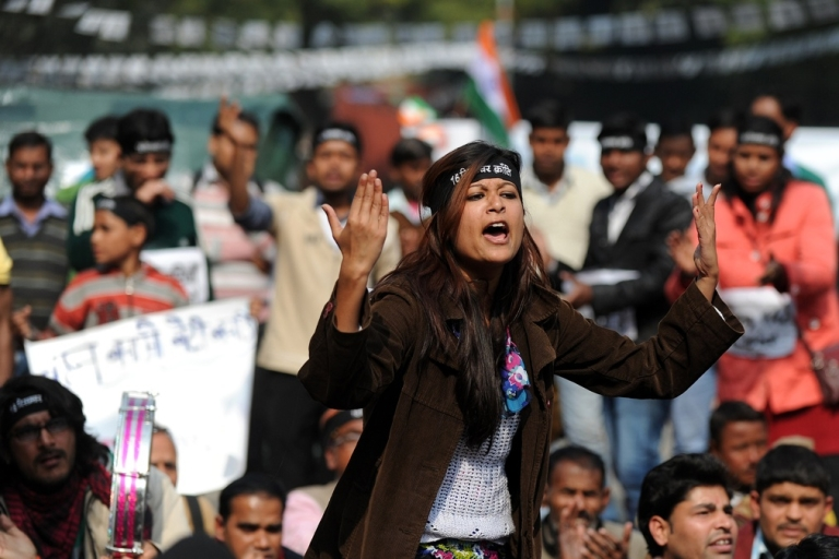 <p>An Indian protester shouts slogans during a protest against the gang rape and murder of a student in New Delhi in December.</p>